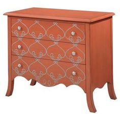 "Bring a touch of heirloom appeal to your foyer, master suite, or den with this 3-drawer wood chest, showcasing scrolling details and a tangerine finish.    Product: ChestConstruction Material: Wood, engineered wood and metalColor: TangerineFeatures: Three drawersScalloped apronScrolling detailsDimensions: 33"" H x 36"" W x 18"" D"
