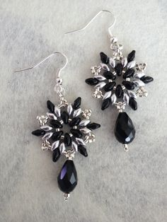 :) Made these earrings february 2015 and used this FREE tutorial: http://www.aroundthebeadingtable.com/Tutorials/Snowflake.html Preciouslady2