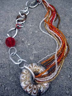 Red and Brown Statement Necklace, Boho Jewelry. Make a statement with this bold asymmetrical necklace!  Looking for other color options, check them out here: www.gennextjewelry.etsy.com  Pin this to your funky jewelry board!  $33
