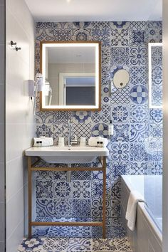 Several bathrooms are decorated in gorgeous blue and white tiles Blue White Bathrooms, White Bathroom Tiles, Bathroom Wall Decor, White Tiles, Bathroom Interior Design, Mosaic Bathroom, Bathroom Designs, French Country Kitchens, French Country Bedrooms