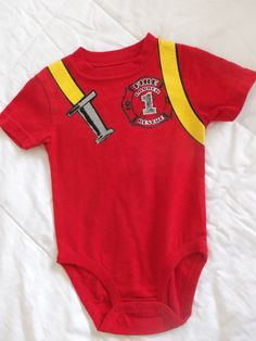 your little man will be helping you put out that fire in this cute little outfit, this is a red onies that has a cute yellow hose on the front, this is a size 6-9 mos. if you have any questions please ask... thank you for looking at my shop, have a nice day... :o)