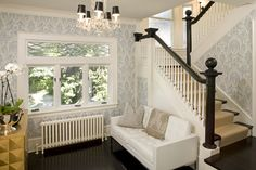 Three casement windows with cranks and a leaded glass transom window marry to create a grand sitting-room window wall.