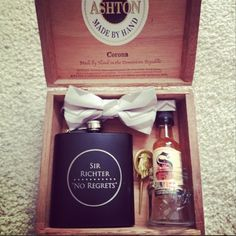 the best groomsman gifts. An old cigar box filled with a personalized flask, moleskine notebook, bow tie, suspenders, shot of whiskey, mason jar shot glass, and for the best man- the Hand of the King pin from Game of Thrones.