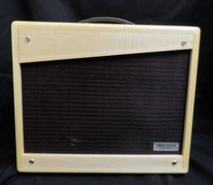"""Features include hand-wired all-tube circuitry with premium components; 12 watts; single channel with high-gain and low-gain inputs; fixed bias for increased headroom; single 12"""" speaker for increased high-gain playing definition; two 6V6 output tubes, two 12AY7 preamp tubes and 5Y3 rectifier tube; Mercury Magnetics custom transformers; solid wood enclosure. This amp is great for a wide array of styles."""