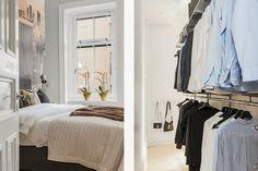 Klädförvaring bakom väggen intill sängen