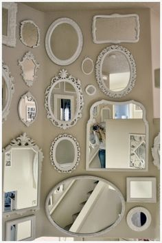 DIY:: Mirror Wall !! by Not So Shabby - Shabby Chic -- These would be easy to find a yard sales and thrift stores then spray painted the same color! Great in a bedroom or in a hallway.