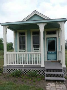 Cute. The rockers and front porch would be a necessity for me:)