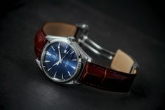 Omega Seamaster Aqua Terra with blue dial on brown alligator strap