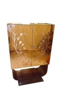 Fall in love by this amazing art deco mirrored cabinet | Discover more contemporary cabinets: http://www.bocadolobo.com/