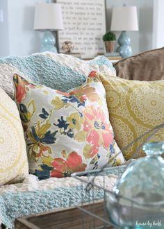 bright pillows on brown sofa