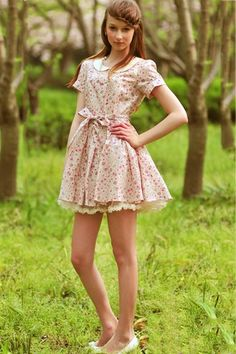 Dress made of cotton, featuring Peter Pan collar with short sleeves, all over floral print with a belt, bound waist design, all in regular fit.