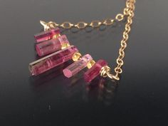 beautiful watermelon tourmaline and gold necklace made by LoveYourThreads on Etsy