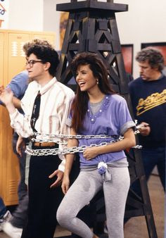 "Tiffani Thiessen, 1991 | Tiffani Thiessen starred as Kelly Kapowski in the '90s sitcom Saved by the Bell that went on to define a generation. In the 11th episode ""Pipe Dreams,"" she was outfitted in layered tees (knotted with a scrunchie, no less) with heather gray leggings."