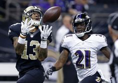 New Orleans Saints wide receiver Joe Morgan (13) pulls in a pass in front of Baltimore Ravens cornerback Lardarius Webb (21) in the first half of an NFL football game in New Orleans, Monday, Nov. 24, 2014. (AP Photo/Jonathan Bachman)