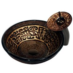 Featuring dark brown and gold patterns with an oil-rubbed bronze-finished faucet, this artistic Vigo vessel sink is an interesting addition to your space. With its handmade solid tempered glass construction, this sink is scratch resistant and unique.