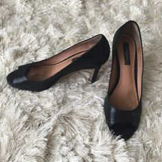 Beautiful Ann Taylor black leather pumps 8M Beautiful Ann Taylor black leather pumps 8M. Used condition, their very comfortable and great to walk all day. Left heel has a minor damage, please see last picture. Ann Taylor Shoes Heels