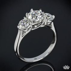 """Butterflies"" 3 Stone Engagement Ring incorporates sweeping lines that twist to create one unforgettable ring. Two 0.50ct side stones."