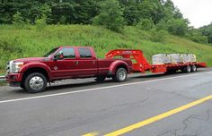 2015 Red  F-150 Ford truck hauling