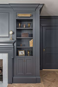 Dark gray painted built in cabinets flank a fireplace in a renovated Tudor home. empotrado, 10 Gorgeous Timeless Design Ideas {The Fox Group} - Hello Lovely Fireplace Built Ins, Bookshelves Built In, Cozy Fireplace, Fireplace Ideas, Styling Bookshelves, Fireplace Bookshelves, Built In Cabinets, Grey Cabinets, Office Cabinets