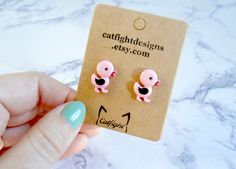 These adorable pink duck earrings, made from upcycled plastic buttons, are perfect in any environment from work to a girls nights out! They are ideal for women, kids, children and girls of any age! Made with nickel-free stainless steel studs (perfect for those with allergies), these adorable studs are available for shipping worldwide!  Each earring measures 0.6 x 0.8 (1.5cm x 2cm).  Want to see more adorable jewelry? Visit Catfight Designs! http://catfightdesigns.etsy.com   **Please...