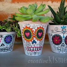 Day of the dead planters...fun way to dress up your greenery