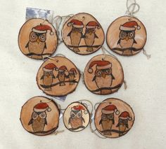 Twelve Owls of Christmas set of 8 Christmas tree ornaments original sand painting on wood slice gift tags packaged in a colorful gift bag. $55.00, via Etsy.