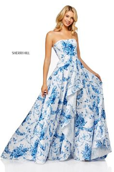 4af90a46867d Sherri Hill 52532 is a strapless floral print prom gown with a front side  cascading ruffle slit on the A-line skirt.