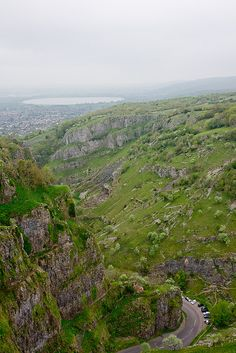 Cheddar Gorge, Somerset. The gorge is famous for its bewildering network of subterranean caves, a few of which are open to the public. Cox's Cave and Gough's Cave , both lined with stalactites and stalagmites, are subtly illuminated to bring out the spectrum of colours in the rock.