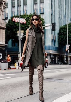 Annabelle Fleur wears roll neck jumper and trench jacket with her leather over the knee boots. Boots: Stuart Weitzman, Jacket: Anthropologie.