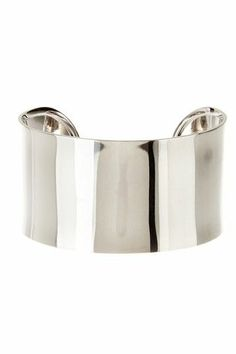 Simple and an easy statement piece year round, you can't go wrong with a wide metal cuff!