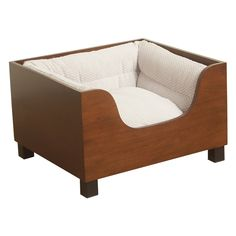 The HomePop Decorative Wood Panel Dog Bed offers a comfy pet bed with a modern silhouette and a warm walnut finish. This dog sofa is ideal for helping keep your furry friends off your furniture.