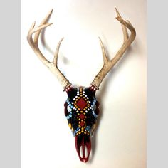 Hand painted Whitetail deer skull is the perfect addition to a unique home.