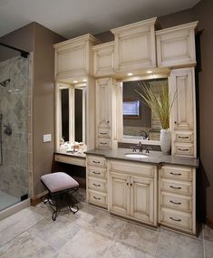 Separate his/hers vanities. I like this layout/design (minus the antique finish and bulky overhead cabinetry). Mullet Cabinet - Custom Master Bathroom Suite featuring separate dressing areas.