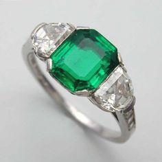 A Tiffany Art Deco three stone emerald and diamond ring, signed Tiffany, circa…
