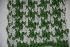 Houndstooth is a fun knitting pattern that involves two different colors of yarn worked on the same row. It's an easy introduction to stranded knitting (aka Fair Isle) and also makes a nice warm fabric.