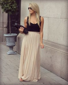 Nude maxi skirt with wide pleats and a loose slub tank in black