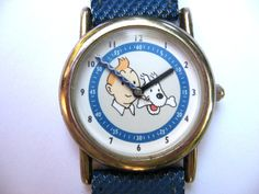 Authentic Tintin Watch, 1994, from France. Adventures of Tintin, and Snowy the dog, by Hergé, Belgian cartoonist Georges Remi. Blue strap. @PumpjackPiddlewick on Etsy