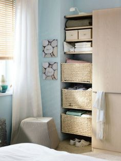 Decent Small Bedroom Decorating Ideas for a Comfortable Bedroom Design: Interesting Small Space Bedroom Storage Solutions With Smart Storage Ideas Rack Level Wicker Basket Combining Ikea Wardrobe Also Blind Window And White Curtains Blue Paint Walls ~ workdon.com Bedroom Design Inspiration