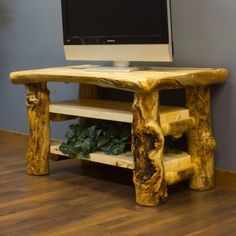"Aspen Log TV Stand can come in either 44"" or 60"" length.  Made in America. Rustic log cabin decor"