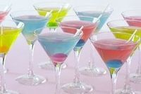 Blow Pop Martinis Ingredients 2/3 cup frozen lemonade concentrate, thawed and strained to remove solids 1 1/3 cups water 1 1/2 cup bubble-gum flavored vodka 4 tbsp sour apple, sour watermelon or berry blue sour liqueur 12 small lollipops, unwrapped, for garnish if desired Recipe by michelle.p