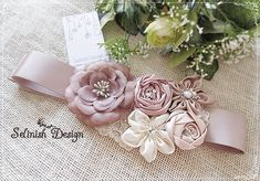 This beautiful, natural looking sash is made of satin and organza rosettes with pearls, crystals and swarovski rhinestones. Each flower is carefully handmade and beaded with bridal quality materials and it attaches to a double faced ribbon, sewed edge finish. Romantic, lovely ,elegant; Wedding Sash, Bridal Flowers, Rosettes, Rhinestones, Vintage Inspired, Swarovski, Ribbon, Trending Outfits, Satin
