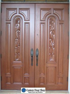 Custom Door Shop's professional sales staff provides tailored services to homeowners, architects, designers, builders and general contractors providing hurricane impact door systems and thousands of different wood styles. Wooden Front Door Design, Double Door Design, Wooden Front Doors, House Front Design, Wooden Double Doors, Wood Doors, Door Design Photos, Steel Gate Design, Front Door Paint Colors
