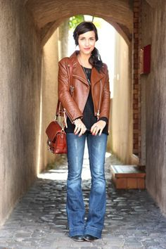 Flared jeans and leather jacket. A comfy cute look. Great for a traveling outfit.