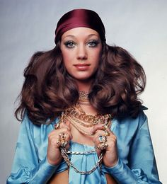 Marisa Berenson in a variety of Bulgari rings and gold chain necklaces, 1969.