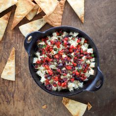 Roasted Feta Saganaki with Roasted Pepper and Olive Relish | Food & Wine