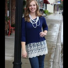Navy top with beautiful lace detail. Navy quarter length top with beautiful lace detail on hem. Tops Tees - Long Sleeve