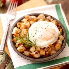 Simple potatoes n chicken with fried eggs.
