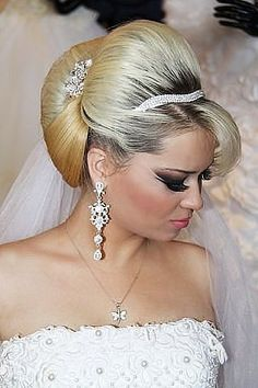 This bride is flaunting her bleach blonde updo with dark outgrowth -- sensational!