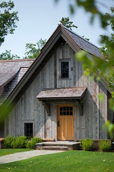 Farm history deeply rooted farms black siding gambrel for Northern wisconsin home builders