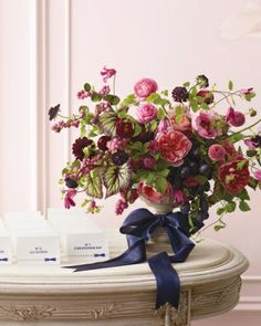 Pink and Navy: Cultivate this palette in your floral arrangements by intermingling plums, black grapes, ball dahlias, and begonia leaves with more familiar pink floral fare.